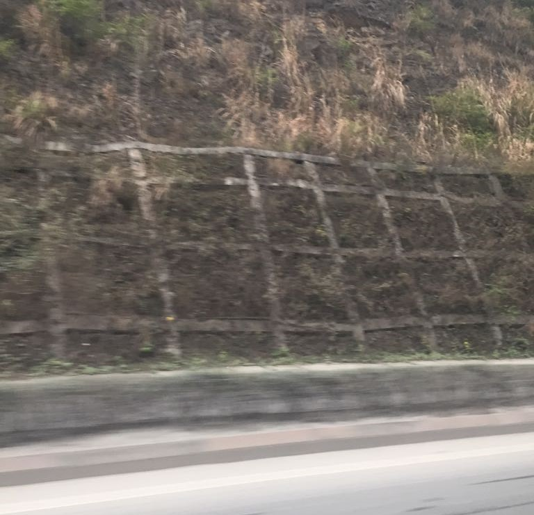 Concrete rectangle grid observed from highway.