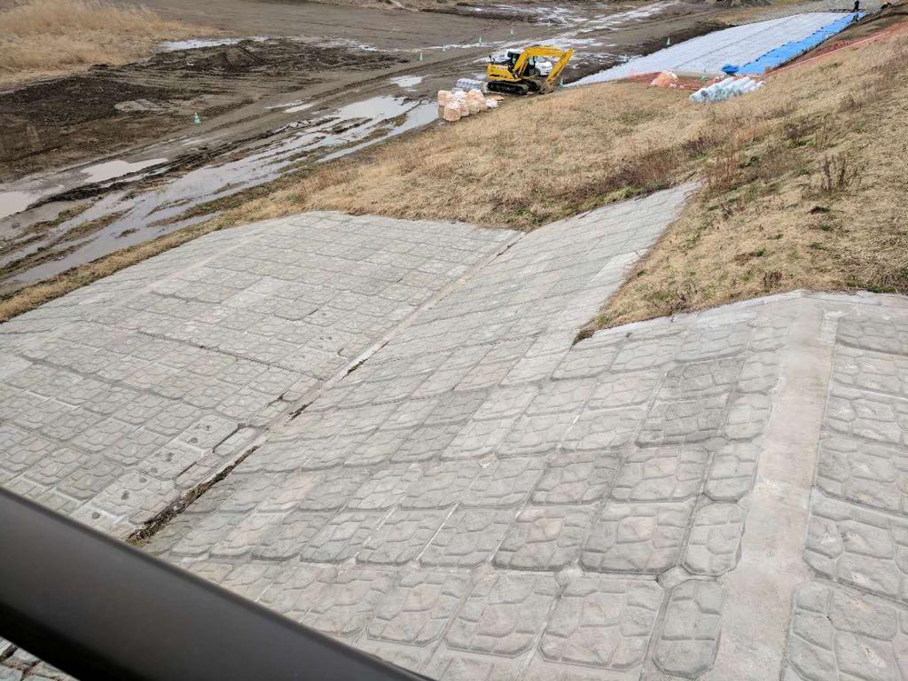 Articulated concrete mat slope protection system near Shida Bridge.